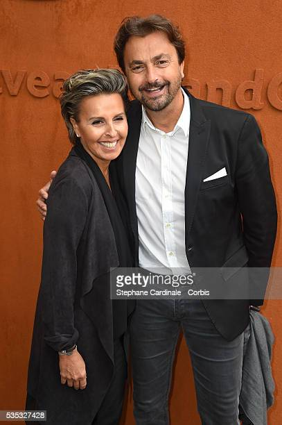 Henri Leconte and Maria Dowlatshahi attend day eight of the 2016 French Open at Roland Garros on May 29 2016 in Paris France