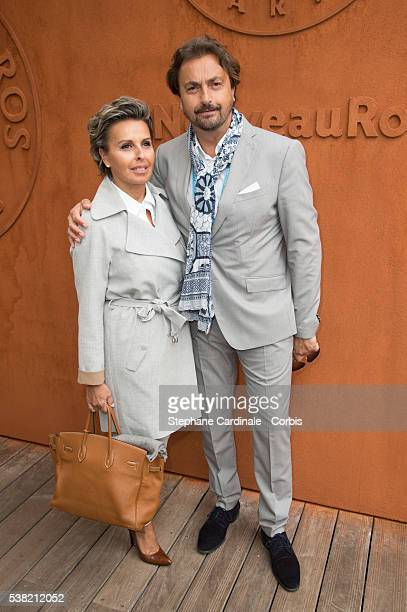 Henri Leconte and Maria Dowlatshahi attend day Fourteen of the 2016 French Open at Roland Garros on June 3 2016 in Paris France