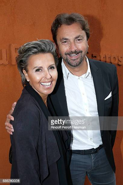Henri Leconte and Maria Dowlatshahi attend Day Height of the 2016 French Tennis Open at Roland Garros on May 29 2016 in Paris France