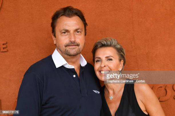 Henri Leconte and Maria Dowlatshahi attend the 2018 French Open Day Seven at Roland Garros on June 2 2018 in Paris France