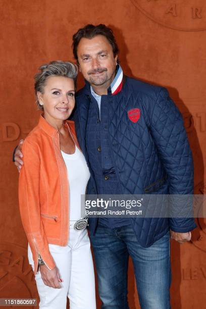 Henri Leconte and Maria Dowlatshahi attend the 2019 French Tennis Open Day One at Roland Garros on May 26 2019 in Paris France