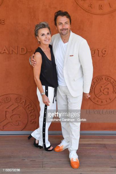 Henri Leconte and Maria Dowlatshahi attend the 2019 French Tennis Open Day Seven at Roland Garros on June 01 2019 in Paris France