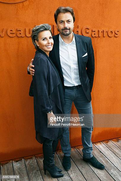 Henri Leconte and Maria Dowlatshahi attend the French Tennis Open Day 8 at Roland Garros on May 29 2016 in Paris France