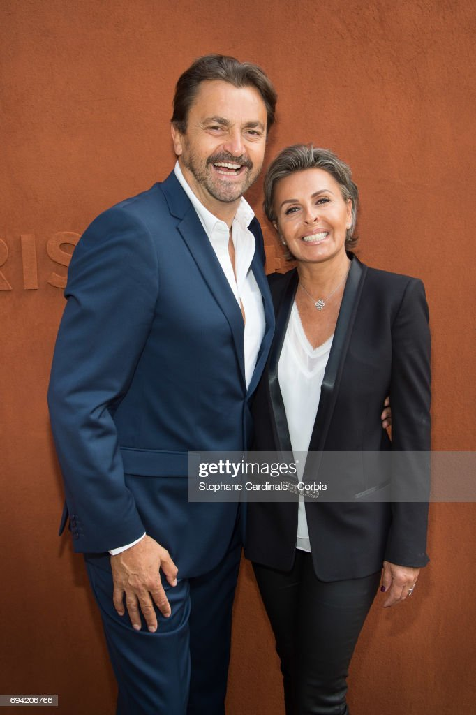 Henri Leconte and Maria Dowlatshahi attend the French Tennis Open 2017 - Day Thirteen at Roland Garros on June 9, 2017 in Paris, France.
