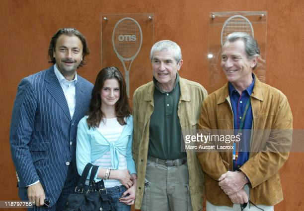 Henri Leconte Claude Lelouch and French TV presenter William Leymergie poses arriving at 'VIP Village' during the French Open Tennis tournament held...