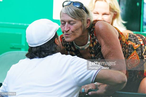 Henri Leconte kisses Heidi Graf mother of Steffi Graf prior to the Warsteiner Champions Trophy of the Gerry Weber Open at the Gerry Weber stadium on...