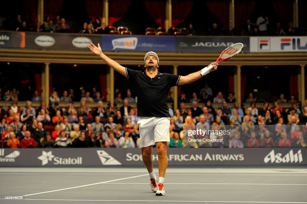 Henri Leconte of France celebrates a point during the match against Mats Wilander of Sweden on Day Three of the Statoil Masters Tennis at the Royal Albert Hall on December 7, 2012 in London, England.