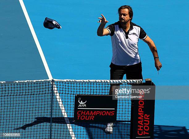 Henri Leconte of France throws 'Bonds' underwear at Pat Rafter of Australia prior to their match during day one of the Champions Downunder at Sydney...