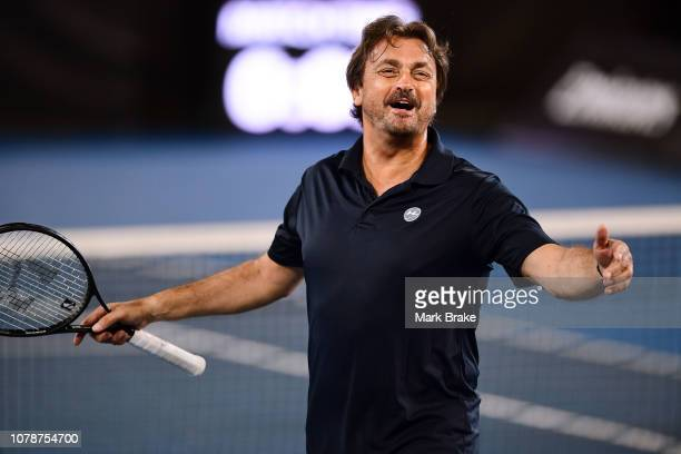 Henri Leconte of Team Leconte in action in doubles with his partner Eugenie Bouchard of Team Cash versus Pat Cash and Borna Coric of Team Cash during...
