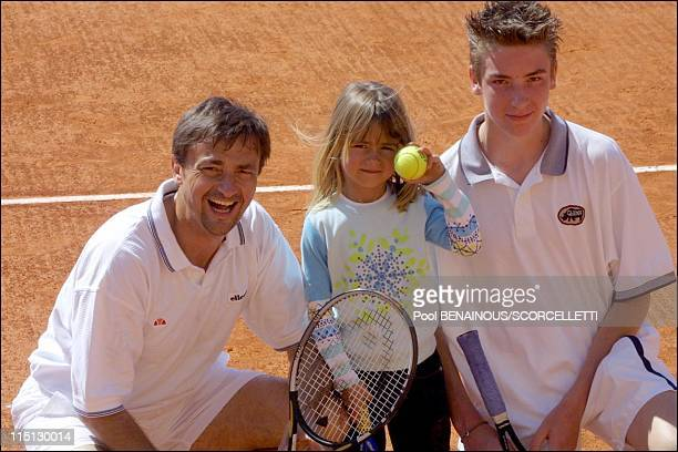 Henri Leconte playing tennis with his children, Sarah Luna and Maxime in Monaco City, Monaco on April 20, 2001.