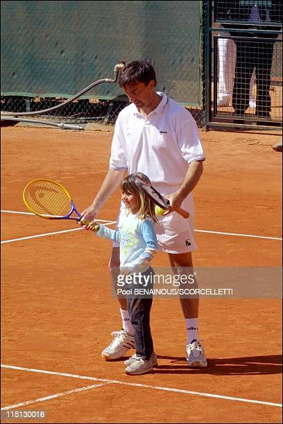 Henri Leconte playing tennis with his children Sarah Luna and Maxime in Monaco City Monaco on April 20 2001 Henri Lecomte and his daughter Sarah Luna