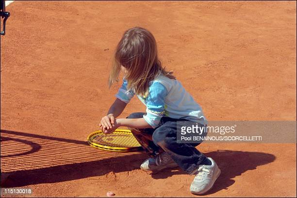 Henri Leconte playing tennis with his children, Sarah Luna and Maxime in Monaco City, Monaco on April 20, 2001 - Sarah Luna Lecomte.