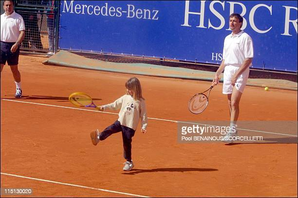 Henri Leconte playing tennis with his children, Sarah Luna and Maxime in Monaco City, Monaco on April 20, 2001 - Sarah Luna and Henri Lecomte.