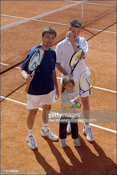 Henri Leconte playing tennis with his children Sarah Luna and Maxime in Monaco City Monaco on April 20 2001