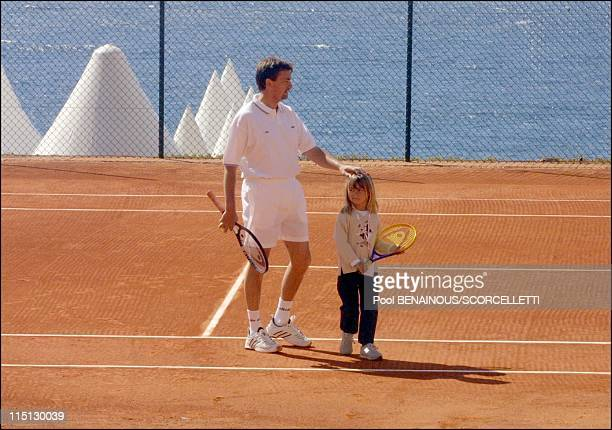 Henri Leconte playing tennis with his children Sarah Luna and Maxime in Monaco City Monaco on April 20 2001 Henri Leconte and his daughter Sarah Luna