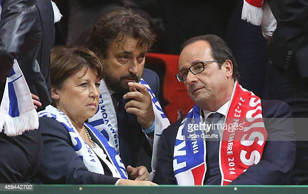 Henri Leconte talks to Mayor of Lille Martine Aubry and French President Francois Hollande during day two of the Davis Cup tennis final between...