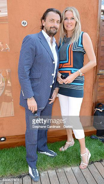 Henri Leconte with his wife Florentine at Roland Garros Village