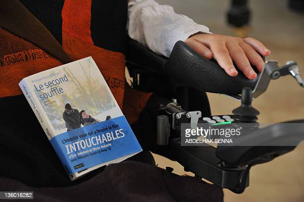 Henri MAMARBACHI French businessman writer and tetraplegique survivor of a parasailing accident Philippe Pozzo di Borgo poses with his book at his...