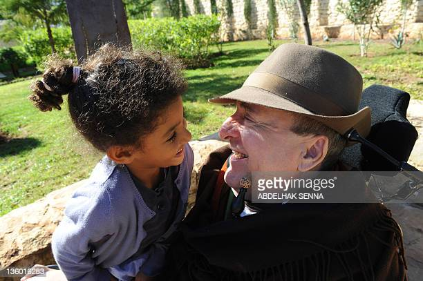 Henri MAMARBACHI French businessman writer and tetraplegique survivor of a parasailing accident Philippe Pozzo di Borgo poses with his daughter...