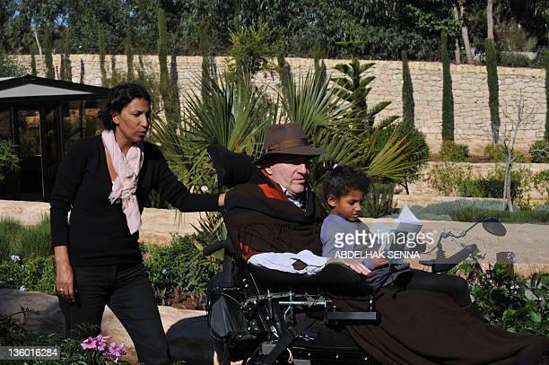 Henri MAMARBACHI French businessman writer and tetraplegique survivor of a parasailing accident Philippe Pozzo di Borgo poses with his wife Khadija...