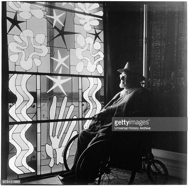 Henri Matisse in Wheelchair Looking at Stained Glass at Chapel of the Rosary, Vence, near Nice, France, 1941.