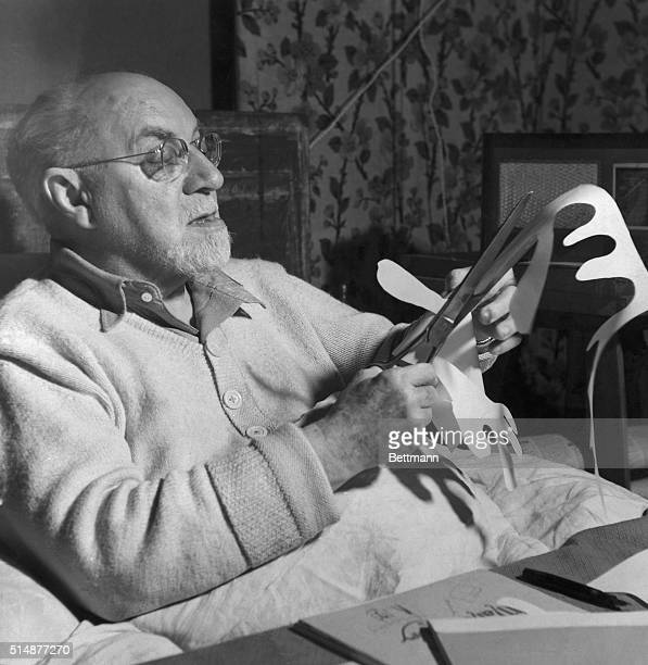 Henri Matisse working on paper cut out. Undated photo.