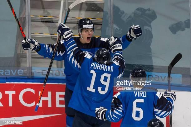 Henri Nikkanen, Petteri Puhakka and Eemil Viro of Finland celebrate a goal against Sweden during the 2021 IIHF World Junior Championship...