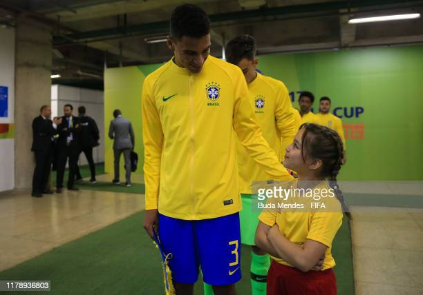 Henri of Brazil greets a child before the FIFA U17 Men's World Cup Brazil 2019 group A match between Brazil and New Zealand at Valmir Campelo...