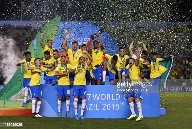 Henri of Brazil lifts the World Cup Trophy during the Final of the FIFA U17 World Cup Brazil 2019 between Mexico and Brazil at the Estadio Bezerrão...