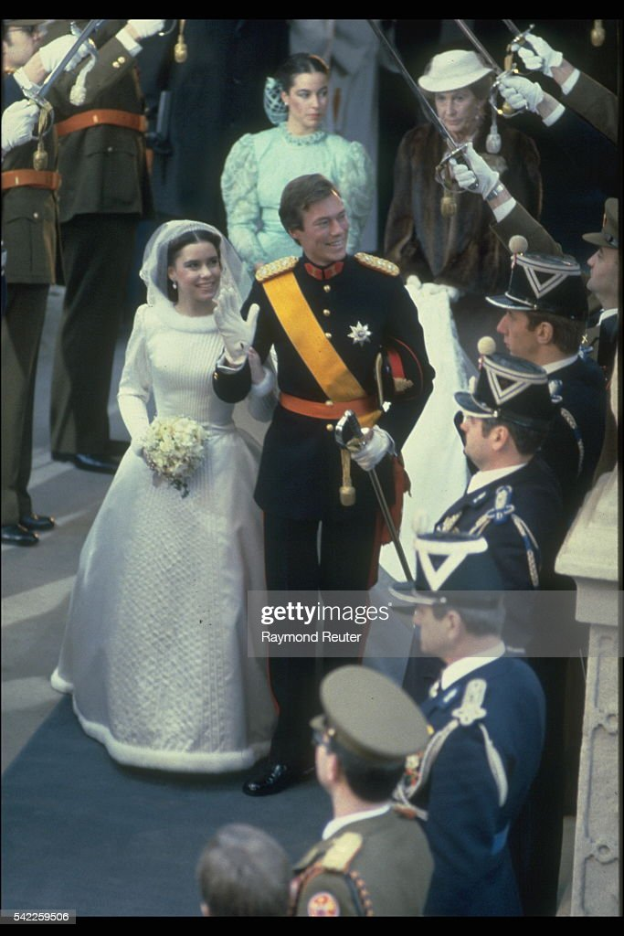 Henri of Luxembourg and Maria Teresa beneath the guard of honor.