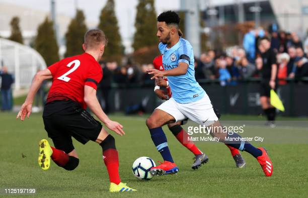 Henri Ogunby of Manchester City takes on Ethan Galbraith of Manchester United during the Under 18 Premier League Cup Semi Final at Manchester City...