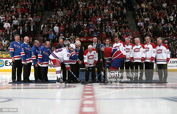 Henri Richard and other former greats of the New York Rangers and Montreal Canadiens drop the puck for a ceremonial faceoff with Saku Koivu of the...