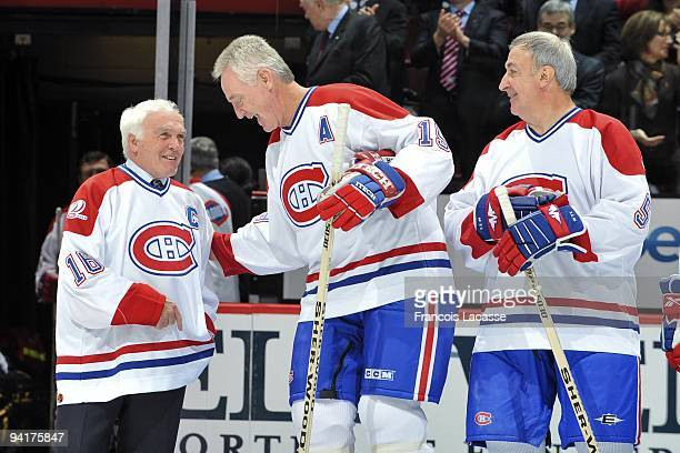 Henri Richard chats with Larry Robinson before the NHL game against the Boston Bruins on December 4 2009 at the Bell Center in Montreal Quebec Canada