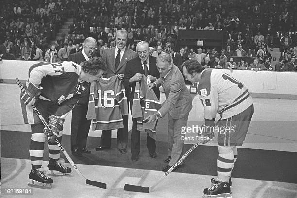 Henri Richard drops the puck during opening face off between Darryl Sittler of the Toronto Maple Leafs and Yvon Cournoyer of the Montreal Canadiens...