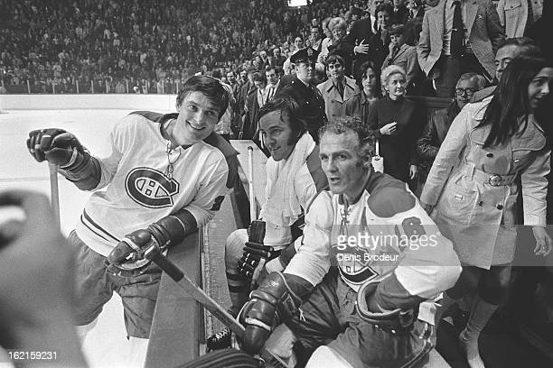 Henri Richard Jean ClaudeTremblay and Peter Mahovlich of the Montreal Canadiens have a chat during a game at the Montreal Forum circa 1970 in...