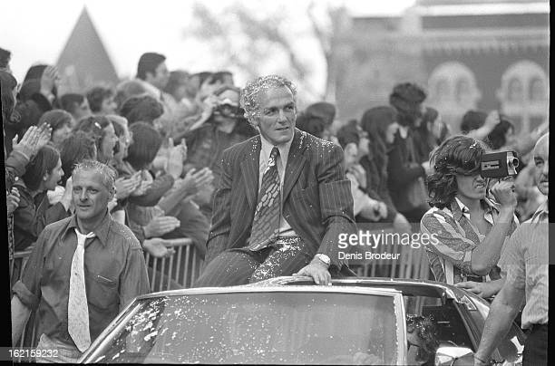Henri Richard of the Montreal Canadiens rides in a car during a parade circa 1975 in Montreal Quebec Canada