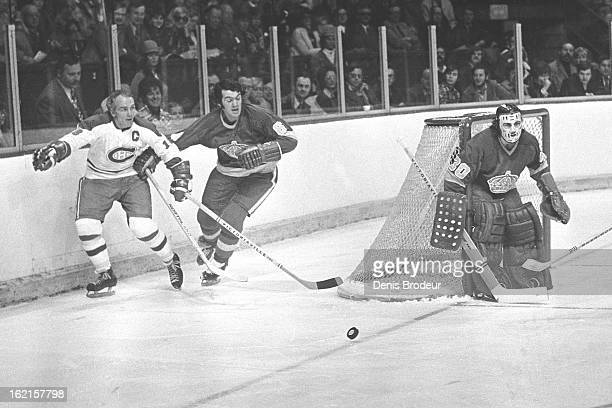 Henri Richard of the Montreal Canadiens skates against Sheldon Kannegiesser of the Los Angeles Kings while goalie Rogatien Vachon of the Kings guards...