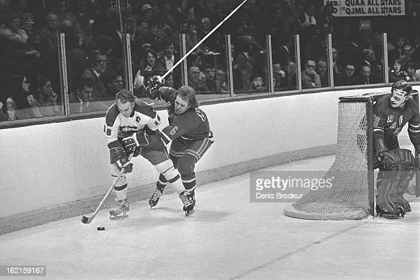 Henri Richard of the Montreal Canadiens skates behind the net against Glen Sather of the New York Rangers as goalie Gilles Villemure fo the Rangers...
