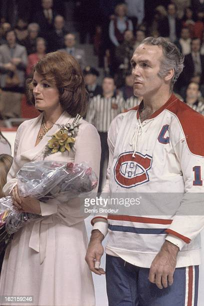 Henri Richard of the Montreal Canadiens stands next to his family during a ceremony to retire his Jersey on December 10 1975 at the Montreal Forum in...