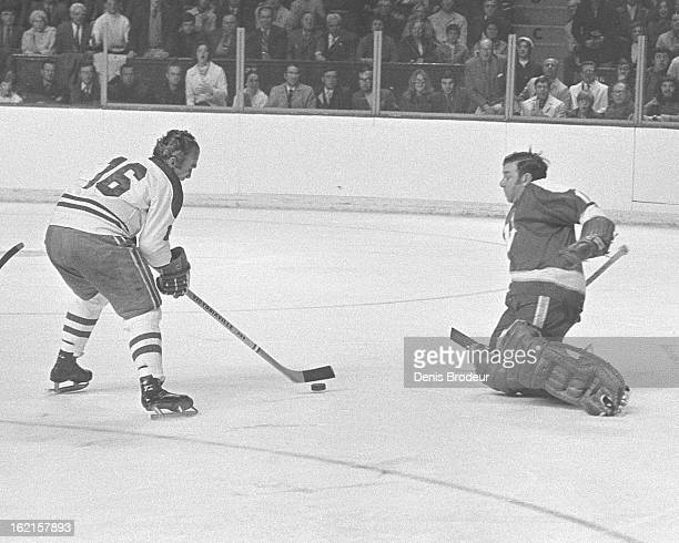 Henri Richard of the Montreal Canadiens tries to get the puck past Gump Worsley of the Minnesota North Stars during a game at the Montreal Forum...