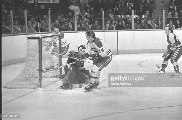 Henri Richard of the Montreal Canadiens tries to shoot the puck past Gilles Meloche of the California Golden Seals during a game at the Montreal...