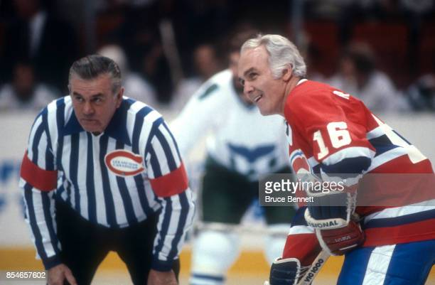 Henri Richard of the Montreal Canadiens waits for the faceoff as his brother Maurice Richard dresses up as the referee during an OldTimers Game...