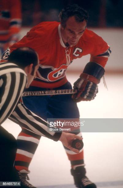 Henri Richard of the Montreal Canadiens waits to take the faceoff during an NHL game circa 1972