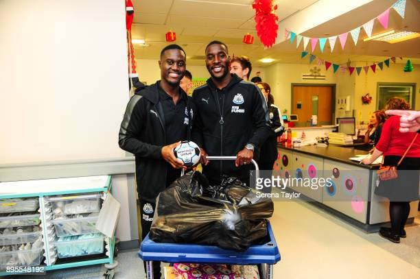 Henri Saivet and Massadio Haidara of Newcastle United push the trolley with gifts for the poorly children during the annual visit to the RVI Hospital...