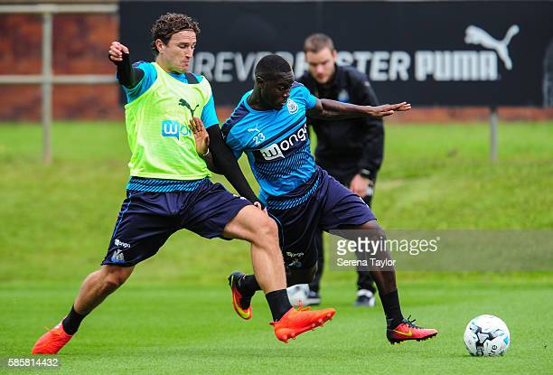 Henri Saivet is challenged by Daryl Janmaat during the Newcastle United training session at the Newcastle United Training Centre on August 4 in...