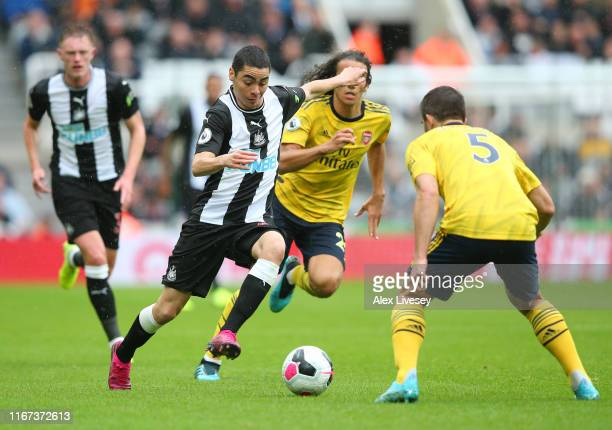Henri Saivet of Newcastle United runs with the ball whilst pressured by Sokratis Papastathopoulos of Arsenal during the Premier League match between...