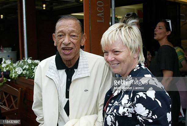 Henri Salvador and his wife pose in the 'Village' the VIP area of the French Open at Roland Garros arena in Paris France on June 3 2007