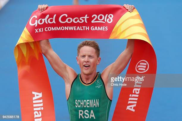 Henri Schoeman of South Africa celebrates winning Gold during the Men's Triathlon on day one of the Gold Coast 2018 Commonwealth Games at Southport...