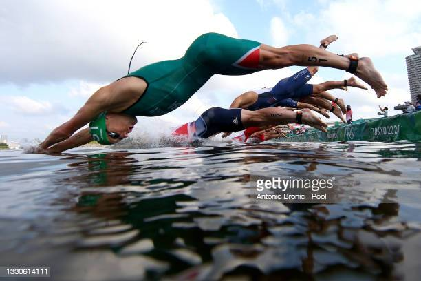 Henri Schoeman of Team South Africa dives into the water at the start of the Men's Individual Triathlon on day three of the Tokyo 2020 Olympic Games...