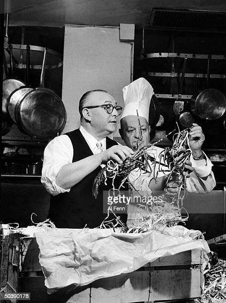 Henri Soule , founder of Le Pavillon, and Chief Chef Clement Grangier inspect live lobsters in the restaurant's kitchen, New York, New York, November...